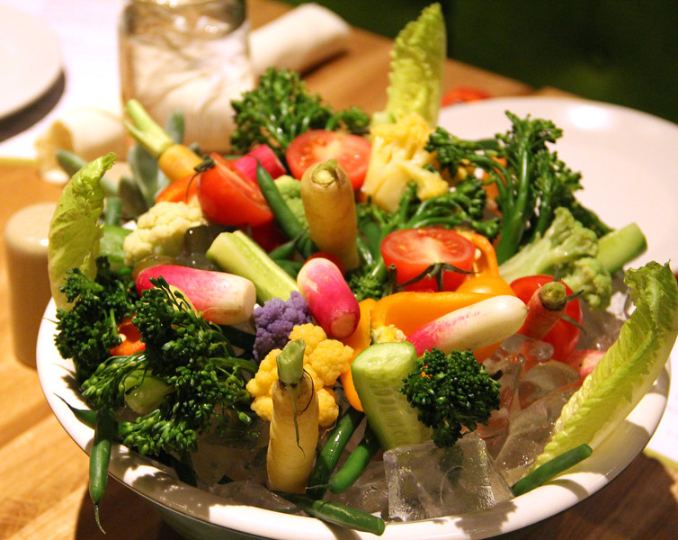 Radishes, purple and yellow cauliflower, green beans, carrots, tomatoes, cucumbers, and broccoli make up this crudités dish - a favorite appetizer on the True Food Kitchen menu.