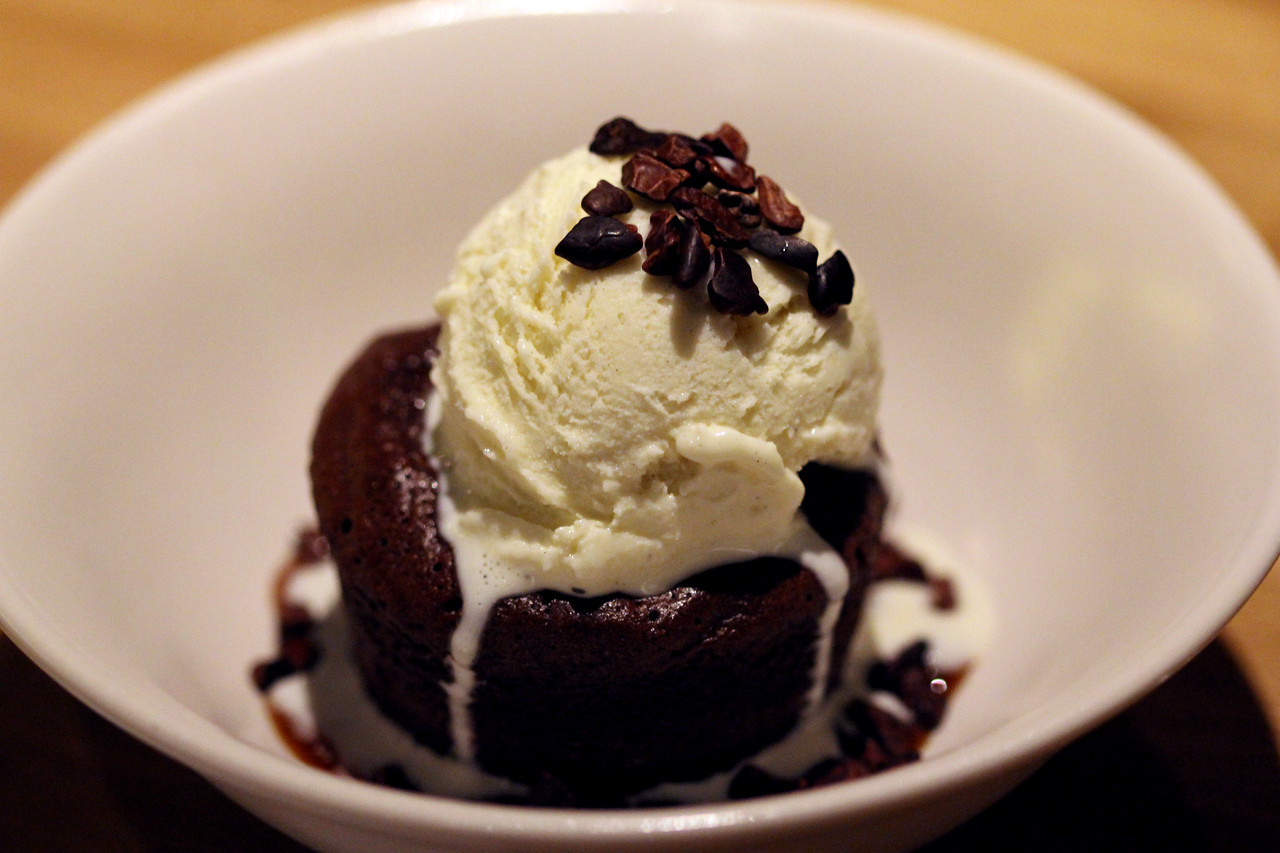 Flourless chocolate cake made with 72% cocoa topped with vanilla ice cream.