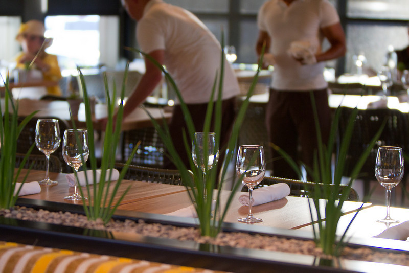 Preparing tables: It's almost time for dinner at the Newport TFK pre-opening.