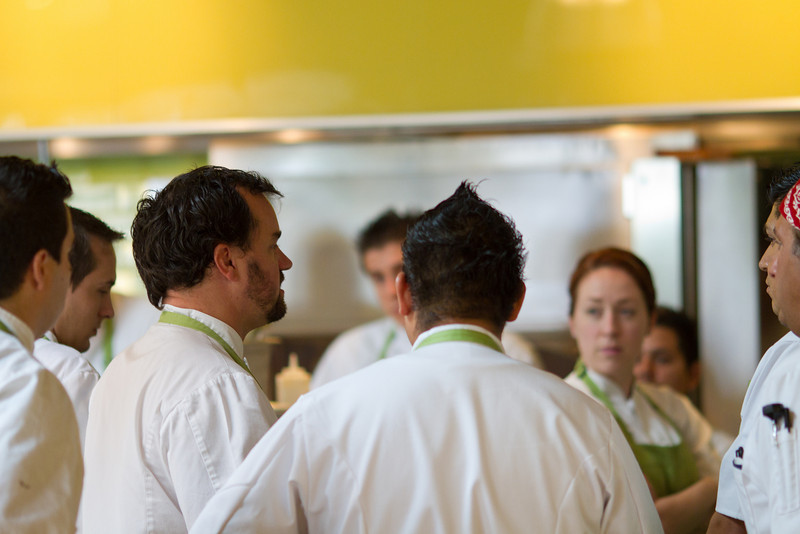 Head chef of the Phoenix True Food Kitchen, Michael Stebner, talks with Newport cooking staff.