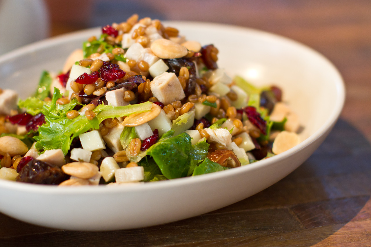 Chicken Chopped Salad: Cranberry, Local Date, Jicama, Manchego, Farro, Marcona Almond & Champagne Vinaigrette.