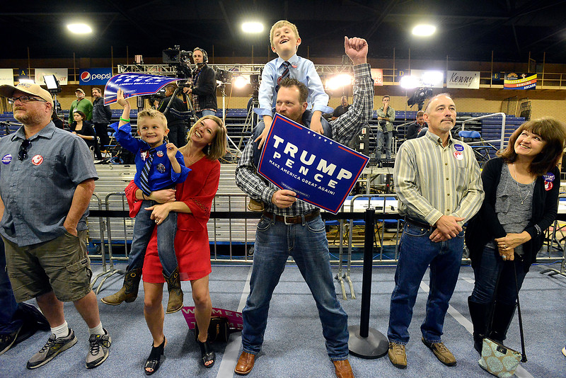 Alissa and Doni Harris hold their sons, Isaac, 4, left, and Noah, 7, right, as they all cheer during the Donald Trump rally Sunday, Oct. 30, 2016, at the Bank of Colorado Arena in the Butler Hancock Athletic Center at the University of Northern Colorado in Greeley. (Photo by Jenny Sparks/Loveland Reporter-Herald)