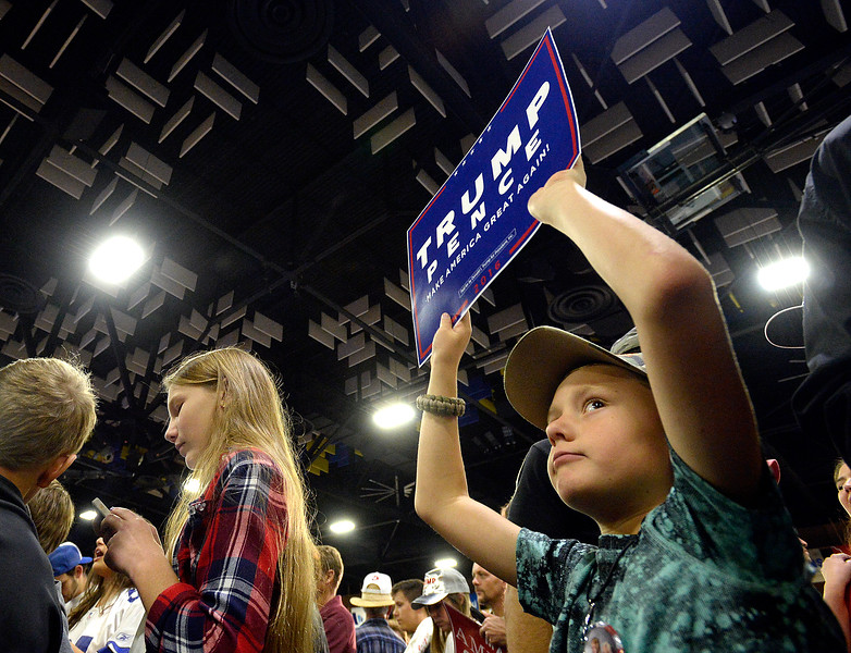Merrick Lendel of Erie, 9, waves a sign during a Donald Trump rally Sunday, Oct. 30, 2016, at the Bank of Colorado Arena at Butler Hancock Athletic Center at the Univeristy of Northern Colorado in Greeley. (Photo by Jenny Sparks/Loveland Reporter-Herald)