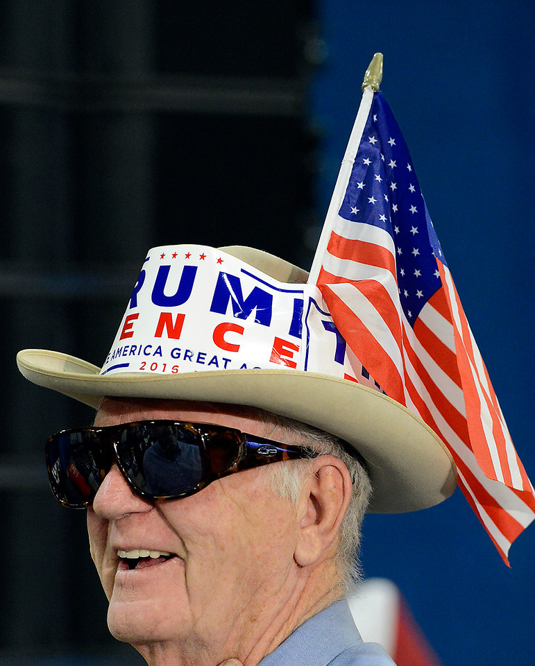 Dallas Horton of Fort Collins wears his cowboy hat complete with Trump stickers and an American flag during the Donald Trump rally Sunday, Oct. 30, 2016, at the Bank of Colorado Arena in the Butler Hancock Athletic Center at the University of Northern Colorado in Greeley. (Photo by Jenny Sparks/Loveland Reporter-Herald)