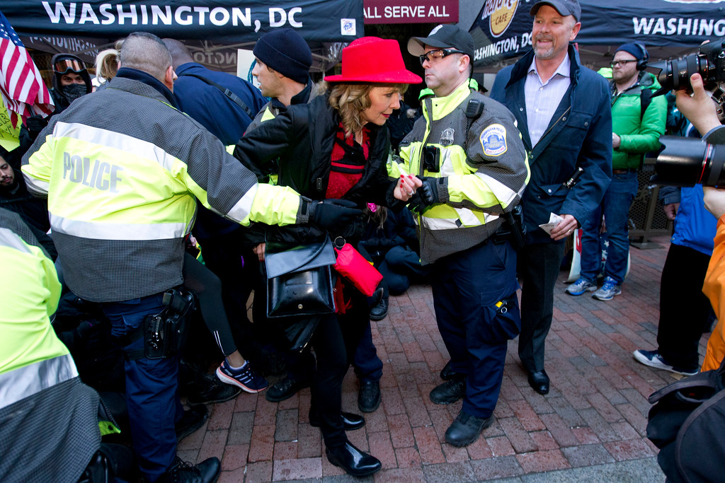. Police assist Inaugural attendees moving through demonstrators attempting to block people entering a security checkpoint, Friday, Jan. 20, 2017, ahead of President-elect Donald Trump\'s inauguration in Washington. ( AP Photo/Jose Luis Magana)
