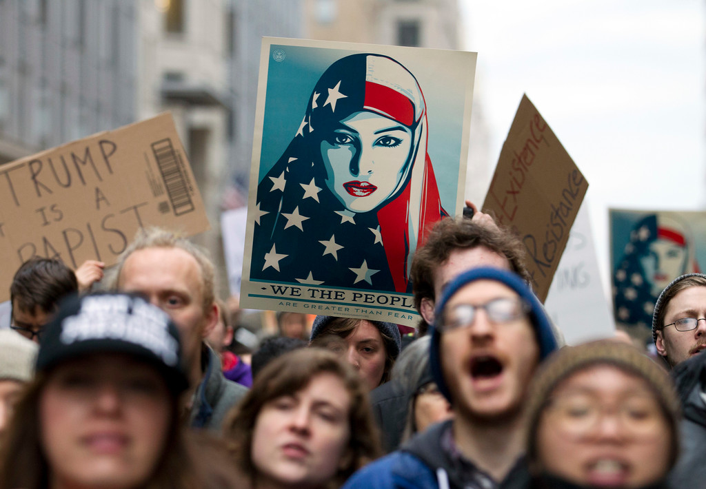 . Demonstrators march on the street near a security checkpoint inaugural entrance, Friday, Jan. 20, 2017 in Washington, ahead of President-elect Donald Trump\'s inauguration. Protesters pitching diverse causes but united against the incoming president are making their mark on Inauguration Day.  ( AP Photo/Jose Luis Magana)