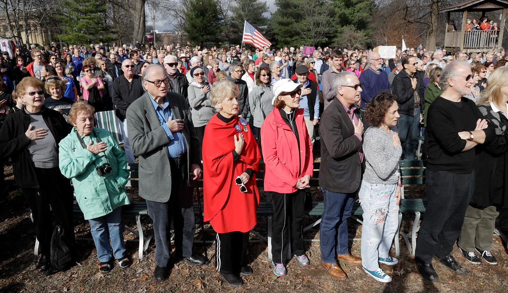 . People recite the Pledge of Allegiance during a protest Friday, Jan. 20, 2017, in Nashville, Tenn., organized to combat harsh rhetoric by Donald Trump. The protesters observed 15 minutes of silence during the time Trump took the Presidential oath of office in Washington. (AP Photo/Mark Humphrey)