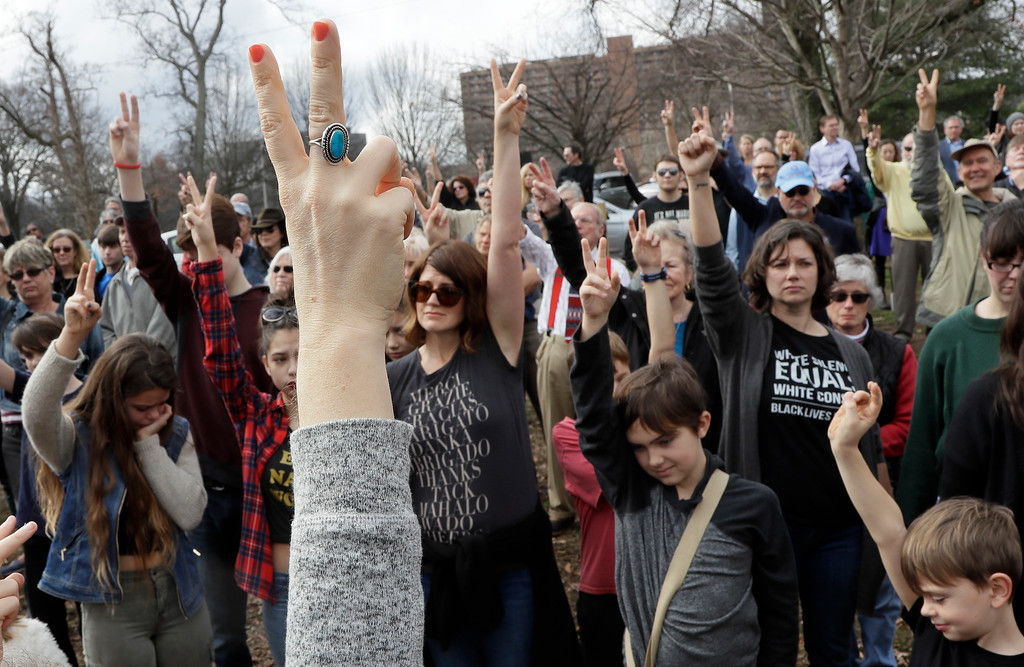 . People take part in a protest Friday, Jan. 20, 2017, in Nashville, Tenn., organized to combat harsh rhetoric by Donald Trump. The protesters observed 15 minutes of silence during the time Trump took the Presidential oath of office in Washington. (AP Photo/Mark Humphrey)
