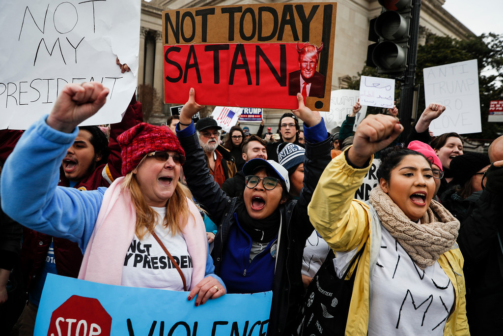 . Protestors chant on the National Mall during a demonstration after the inauguration of President Donald Trump, Friday, Jan. 20, 2017, in Washington. (AP Photo/John Minchillo)