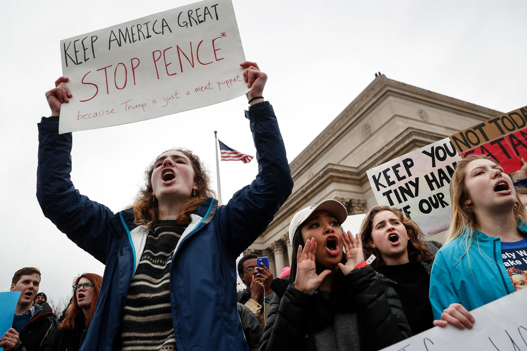 . Protesters chant on the National Mall during a demonstration after the inauguration of President Donald Trump, Friday, Jan. 20, 2017, in Washington. (AP Photo/John Minchillo)