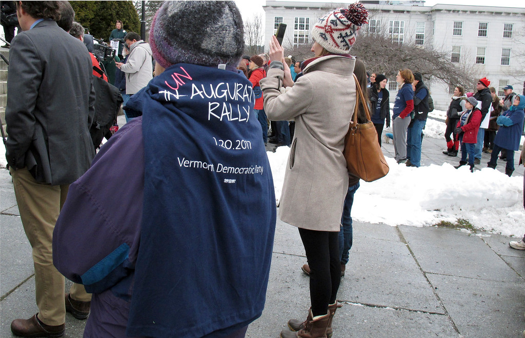 ". A woman wears a T-shirt commemorating an ""Un-augural Rally\"" on Friday, Jan. 20, 2017, in Montpelier, Vt., to protest the inauguration of President Donald Trump in Washington. About 100 activists gathered on the steps of the Vermont Statehouse for the protest. (AP Photo/Wilson Ring)"