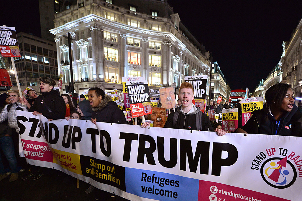 . A demonstration against US President Donald Trump takes place in Oxford Circus, central London, Friday Jan. 20, 2017. Trump was sworn-in in Washington as the 45th president of the United States on Friday. (Dominic Lipinski/PA via AP)