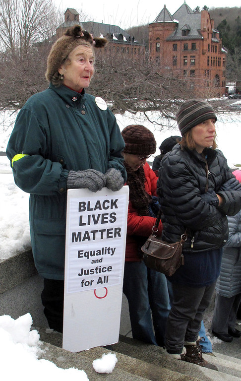 ". Ann Burcroff holds a ""Black Lives Matter\"" sign at an \""Un-augural Rally\"" protest Friday, Jan. 20, 2017, in Montpelier, Vt., to protest the inauguration of President Donald Trump in Washington. About 100 activists gathered on the steps of the Vermont Statehouse to protest. (AP Photo/Wilson Ring)"