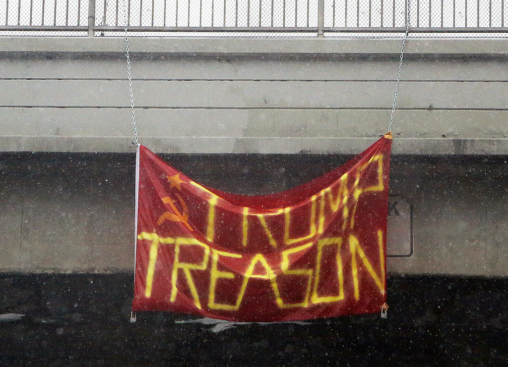 . A rain-soaked anti-Donald Trump banner hangs from an overpass on the Santa Monica Freeway (Interstate 10) during a downpour in Los Angeles Friday, Jan. 20, 2017. Protests have taken place in California and elsewhere on the day that Trump was inaugurated president of the United States. (AP Photo/Reed Saxon)