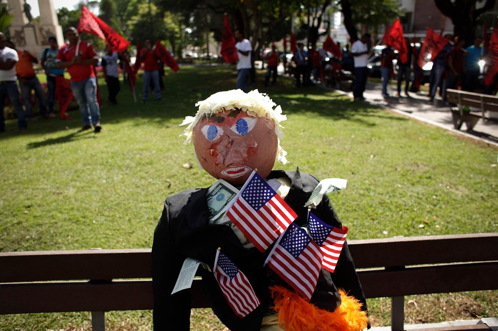 . An effigy depicting U.S. President Donald Trump sits on a bench before a protest in Panama City, Friday, Jan. 20, 2017. Donald Trump took the oath of office as the 45th president of the United States. (AP Photo/Arnulfo Franco)