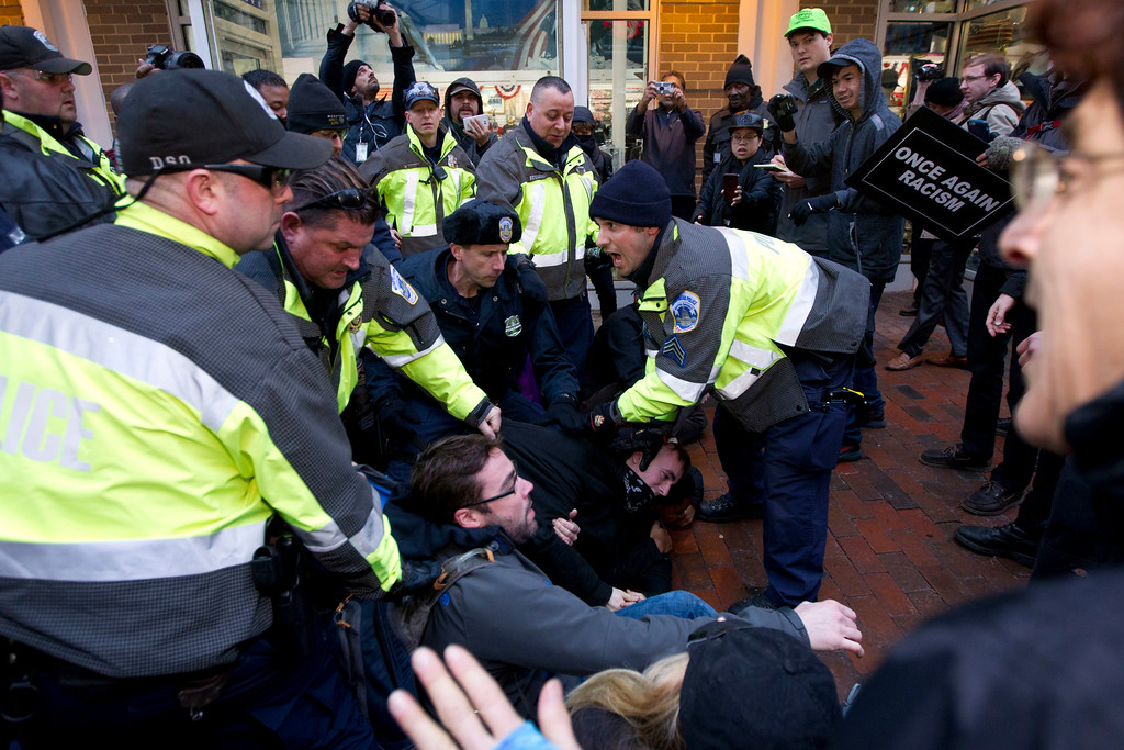 . Police try to remove demonstrators from attempting to block people entering a security checkpoint, Friday, Jan. 20, 2017, ahead of President-elect Donald Trump\'s inauguration in Washington. ( AP Photo/Jose Luis Magana)