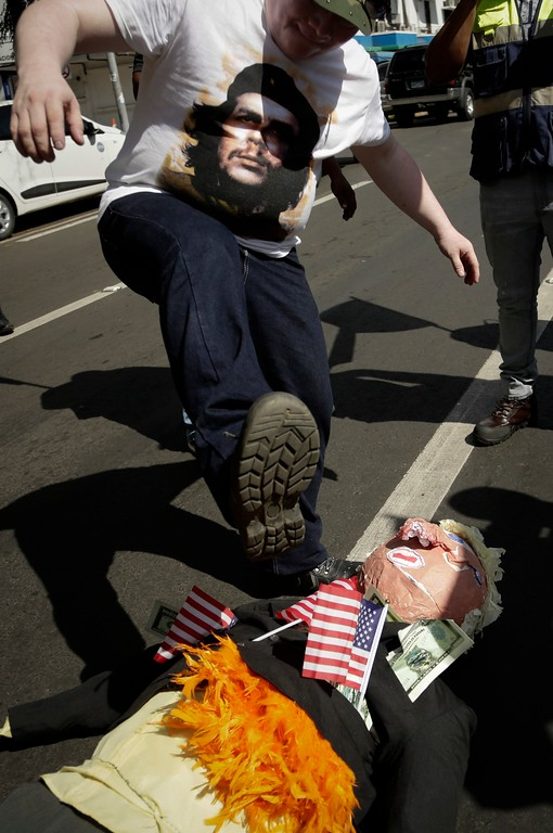. A man stomps on an effigy depicting U.S. President Donald Trump during a protest in Panama City, Friday, Jan. 20, 2017. Donald Trump took the oath of office as the 45th president of the United States. (AP Photo/Arnulfo Franco)