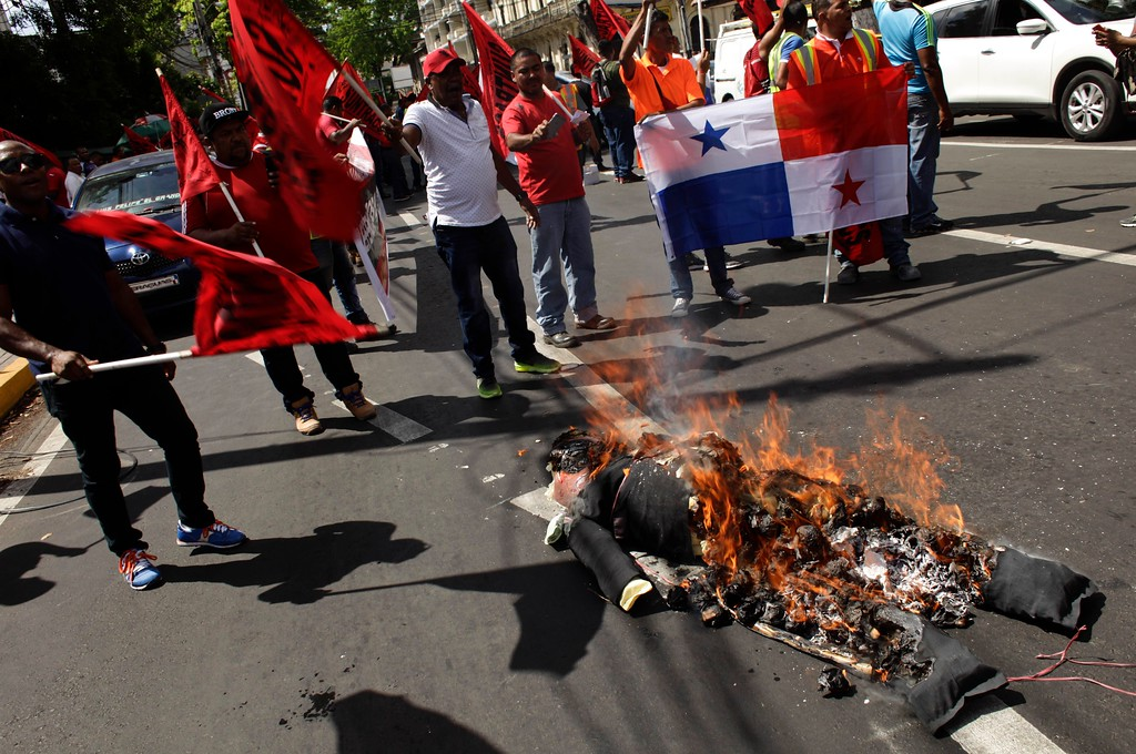 . Demonstrators burn an effigy depicting U.S. President Donald Trump during a protest in Panama City, Friday, Jan. 20, 2017. Donald Trump took the oath of office as the 45th president of the United States. (AP Photo/Arnulfo Franco)