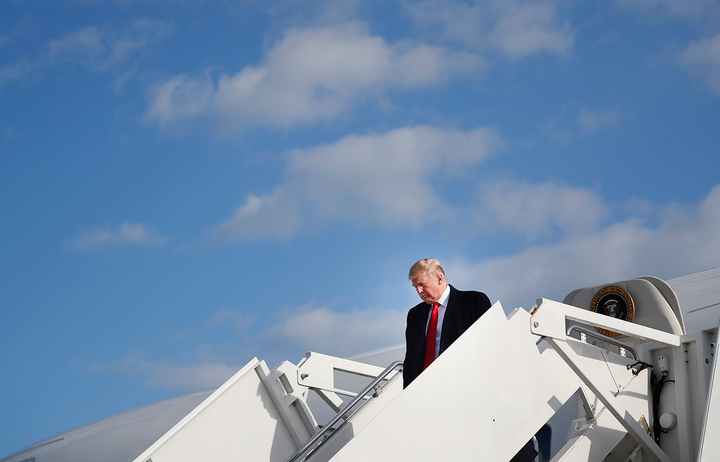 . President Donald Trump walks down the stairs during his arrival on Air Force One at Selfridge Air National Guard Base, Mich., Saturday, April 28, 2018. (AP Photo/Pablo Martinez Monsivais)