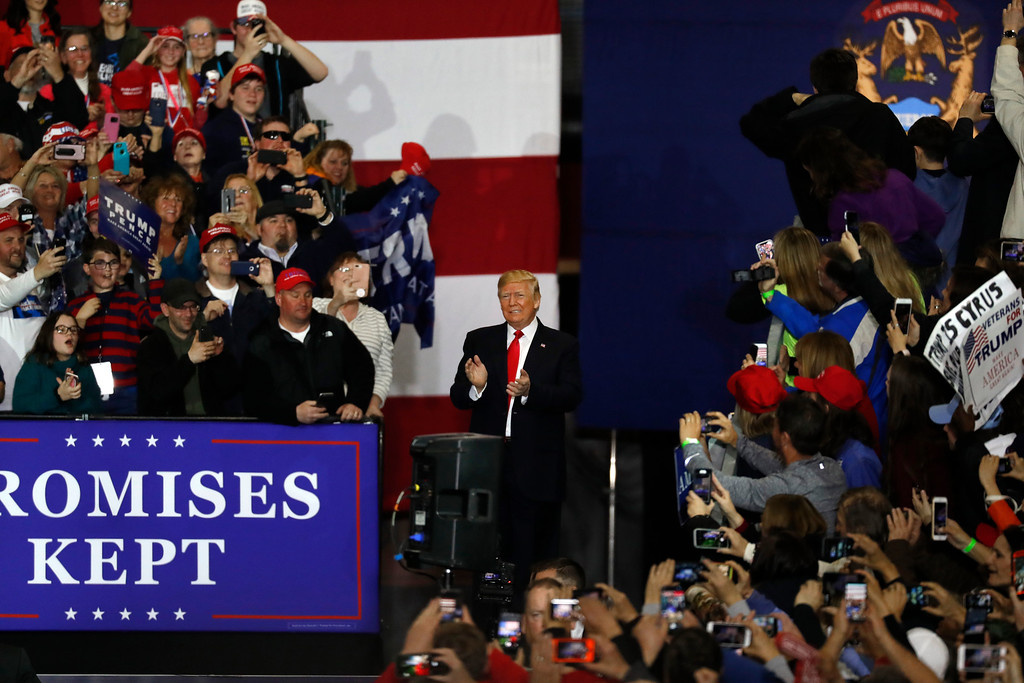 . U.S. President Donald Trump arrives for a campaign rally in Washington Township, Mich., Saturday, April 28, 2018. (AP Photo/Paul Sancya)