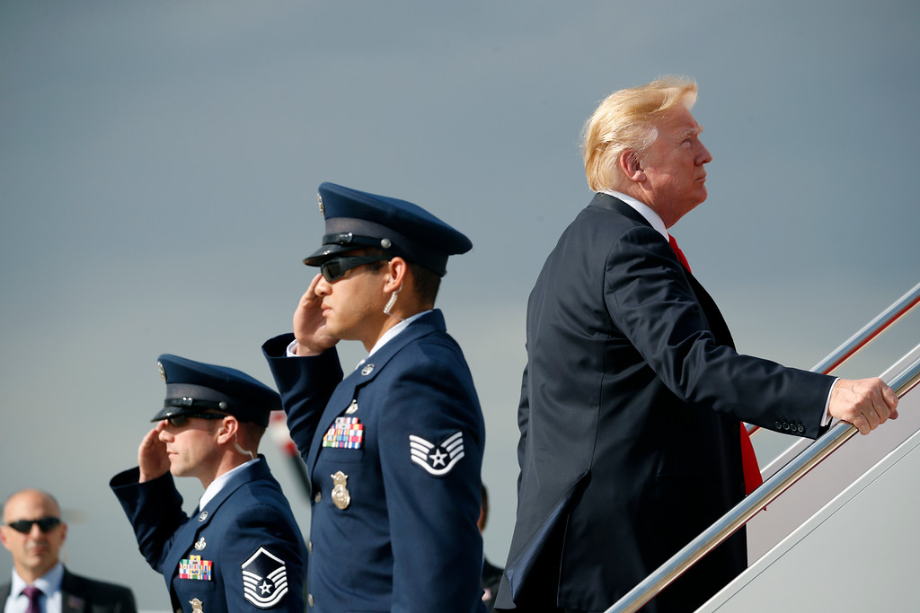 . President Donald Trump boards Air Force One during his departure from Andrews Air Force One Base, Md., Saturday, April 28, 2018. Trump is traveling to Michigan to speak at a rally on the same night as the White House Correspondent\'s Dinner, the second straight year Trump has skipped the event with the White House Press Corps. (AP Photo/Pablo Martinez Monsivais)