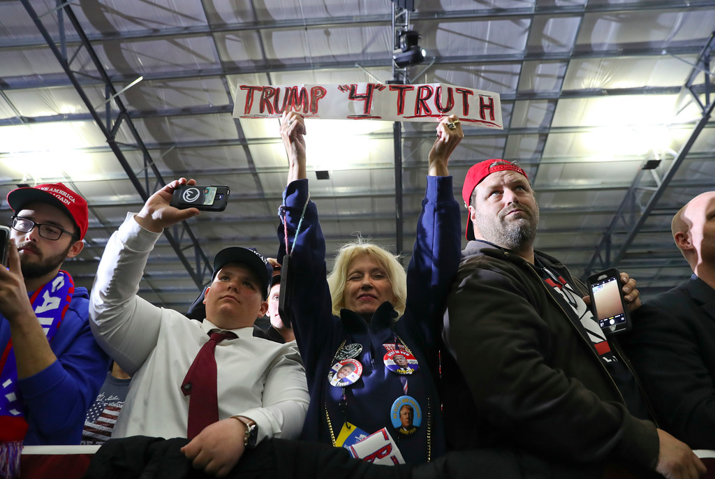 . Supporters listen to President Donald Trump speak at a rally at Total Sports Park Saturday, April 28, 2018, in Washington, Mich. (AP Photo/Pablo Martinez Monsivais)