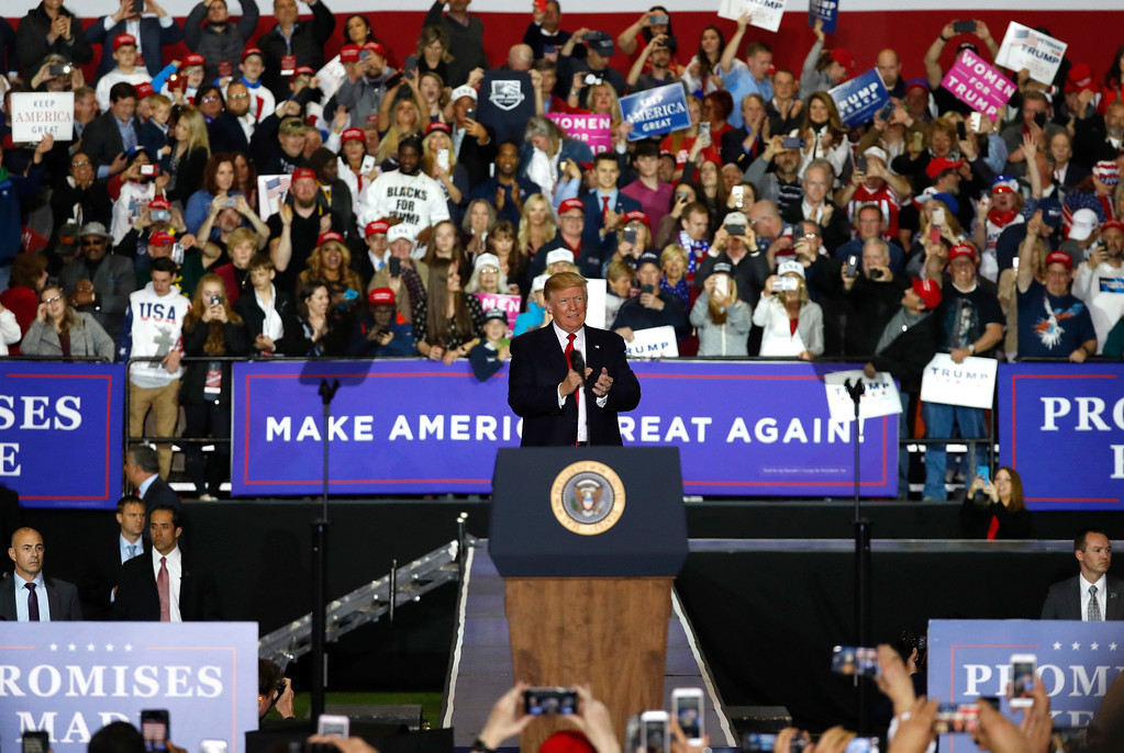 . President Donald Trump arrives at a campaign rally in Washington Township, Mich., Saturday, April 28, 2018. (AP Photo/Paul Sancya)