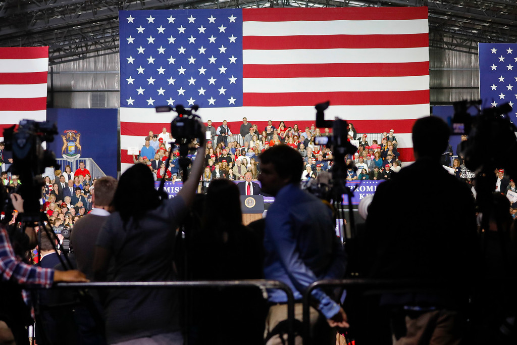 . Journalist stand on the press riser to cover President Donald Trump\'s remarks at a rally at Total Sports Park Saturday, April 28, 2018, in Washington, Mich. (AP Photo/Pablo Martinez Monsivais)