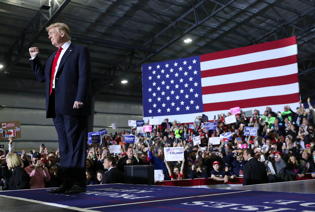 . President Donald Trump gestures as he is introduced at a rally at Total Sports Park Saturday, April 28, 2018, in Washington, Mich. (AP Photo/Pablo Martinez Monsivais)