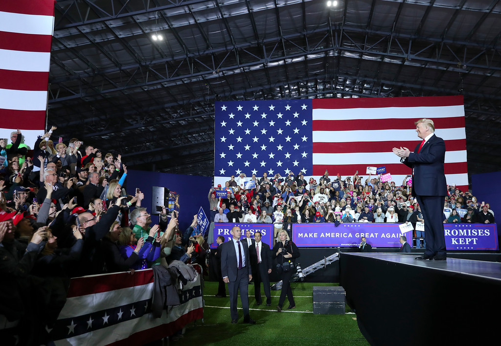 . President Donald Trump stops to applaud supporters as he is introduced at a rally at Total Sports Park Saturday, April 28, 2018, in Washington, Mich. (AP Photo/Pablo Martinez Monsivais)