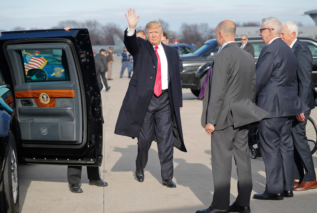. President Donald Trump waves from the tarmac upon arrival on Air Force One at Selfridge Air National Guard Base, Mich., Saturday, April 28, 2018. (AP Photo/Pablo Martinez Monsivais)