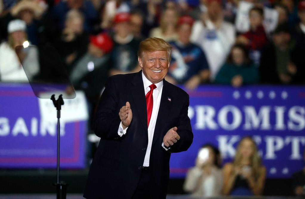 . U.S. President Donald Trump arrives at a campaign rally in Washington Township, Mich., Saturday, April 28, 2018. (AP Photo/Paul Sancya)