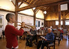 HOLLY PELCZYNSKI - BENNINGTON BANNER Gina Anzivino, Membership Coordinator at Bennington Project for Independence takes a break from the desk work to play some tunes for members in the barn at on Thursday morning in Bennington.