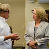 Applewild School Headmaster Christie Stover speaks with Congresswoman Niki Tsongas during a roundtable discussion in honor of Womens Equality Day at Fitchburg State University on Friday afternoon. SENTINEL & ENTERPRISE / Ashley Green