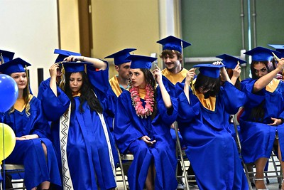 Tsurai High School graduates switch their tassels over to the side. (José Quezada — For the Times-Standard)