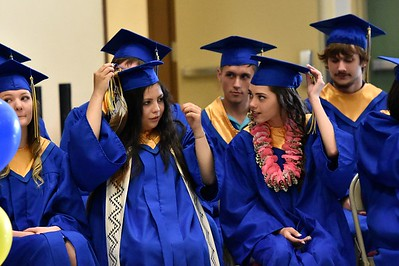 Tassels get turned to the other side signifying completion of state standards for high school graduation. (José Quezada — For the Times-Standard)