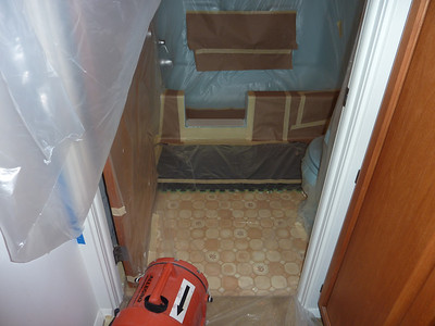 All Masked off, to protect the rest of the bathroom from over-spray.  The orange item is a powerful fume extractor.