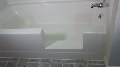 All finished & another happy customer!!! ... the bottom, of the cut-out is gently sloped into the tub, to the same degree as the tub bottom, in order to have any water that may get on it stay inside the tub.