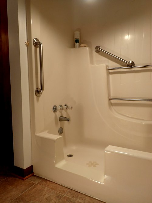 All Finished,  including Stainless Steel Grab Bars.  Just step in & enjoy a warm soothing shower.