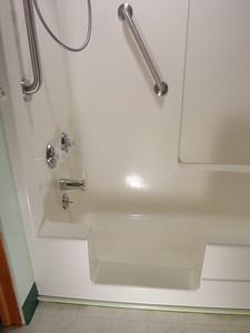 Completed with a durable finish & stainless steel grab bars.