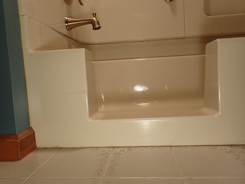 """The finished Conversion ... the step is only 4"""" from the floor, because the inside bottom of the tub was so low ... wish all the tubs had a low bottom ... the higher the interior bottom, the higher I have to make the step."""