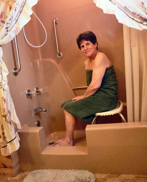 With the cut-out & grab bars, she can comfortably take her shower. (Thanks Edie for being my beautiful model).