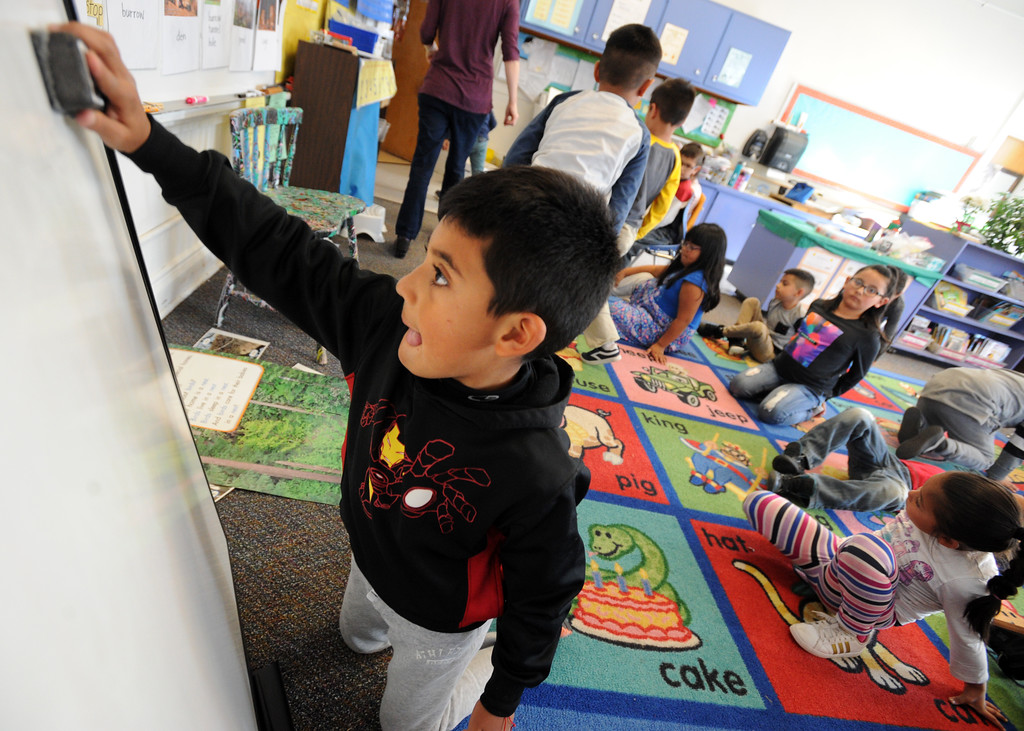 . Angel Torrez, a first-grader, erases the board in Mary Gilreath\'s class  at University Hill Elementary on Tuesday. Cliff Grassmick  Photographer November 14, 2017