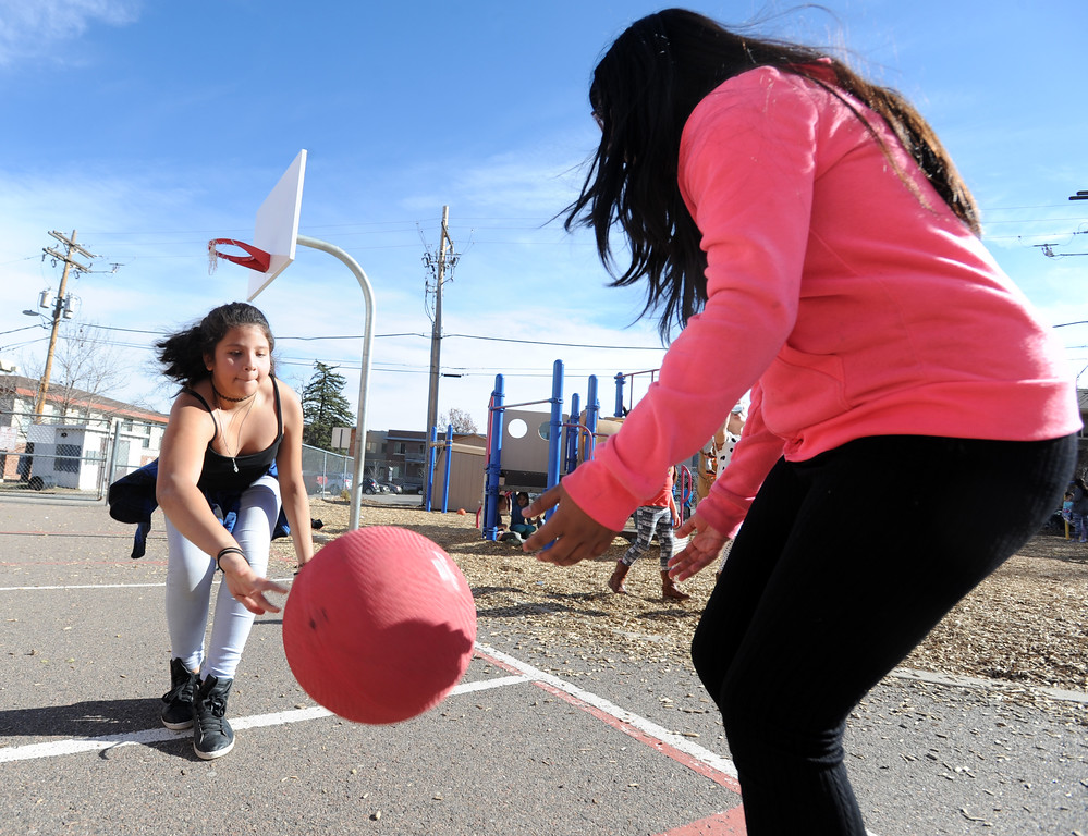 . April Morales, left, and Betsy Lopez play foursquare with other fifth-graders  at University Hill Elementary on Tuesday. Cliff Grassmick  Photographer November 14, 2017