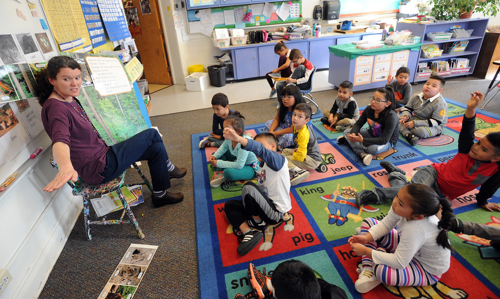 . Mary Gilreath works with her first-graders  at University Hill Elementary on Tuesday. Cliff Grassmick  Photographer November 14, 2017
