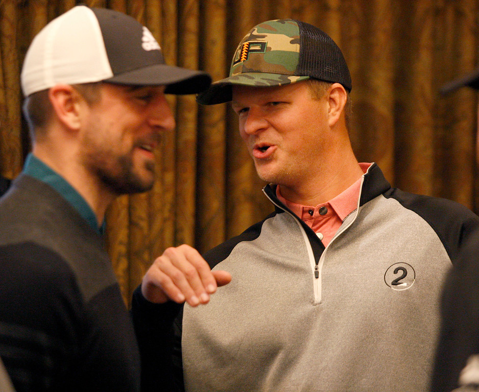 . Aaron Rodgers talks with Matt Cain while they play indoors during the modified Chevron Shoot-Out charity event at the Pebble Beach Golf Links at the AT&T Pebble Beach Pro Am on Tuesday, Feb. 7, 2017.   (Vern Fisher - Monterey Herald)