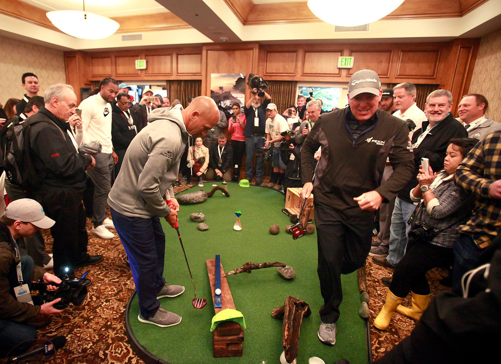 . Pro surfer Kelly Slater attempts a putt with his partner D.A. Points indoors during the modified Chevron Shoot-Out charity event at the Pebble Beach Golf Links at the AT&T Pebble Beach Pro Am on Tuesday, Feb. 7, 2017.   (Vern Fisher - Monterey Herald)