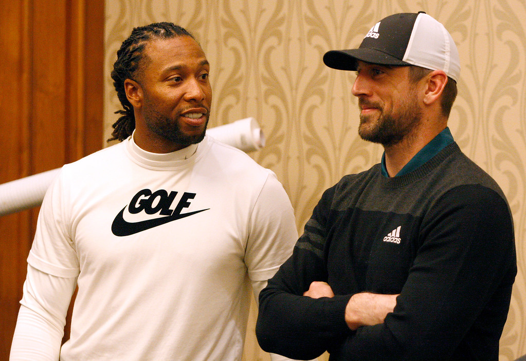 . Larry Fitzgerald talks with Aaron Rodgers as they play indoors during the modified Chevron Shoot-Out charity event at the Pebble Beach Golf Links at the AT&T Pebble Beach Pro Am on Tuesday, Feb. 7, 2017.   (Vern Fisher - Monterey Herald)