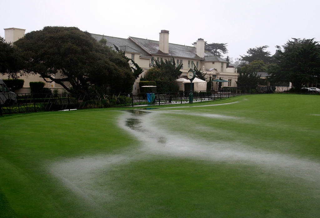 . The practice green at the Pebble Beach Golf Links illustrates the saturated conditions in store for the AT&T Pebble Beach Pro Am on Tuesday, Feb. 7, 2017.   (Vern Fisher - Monterey Herald)