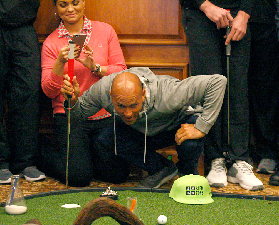. Pro surfer Kelly Slater lines up a putt indoors during the modified Chevron Shoot-Out charity event at the Pebble Beach Golf Links at the AT&T Pebble Beach Pro Am on Tuesday, Feb. 7, 2017.   (Vern Fisher - Monterey Herald)